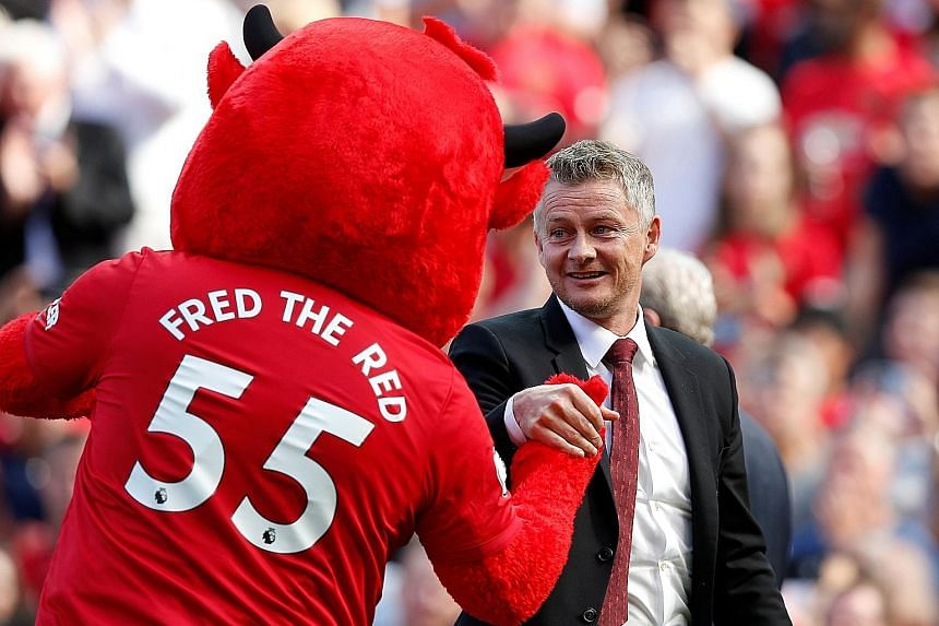 Manchester United manager Ole Gunnar Solskjaer and the club mascot before a match at Old Trafford.