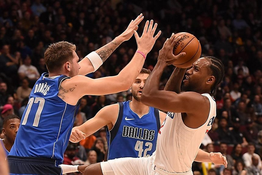 Los Angeles Clippers forward Kawhi Leonard being blocked by two Dallas Mavericks players in their pre-season game in Vancouver, Canada on Thursday. The Mavericks won 102-87.