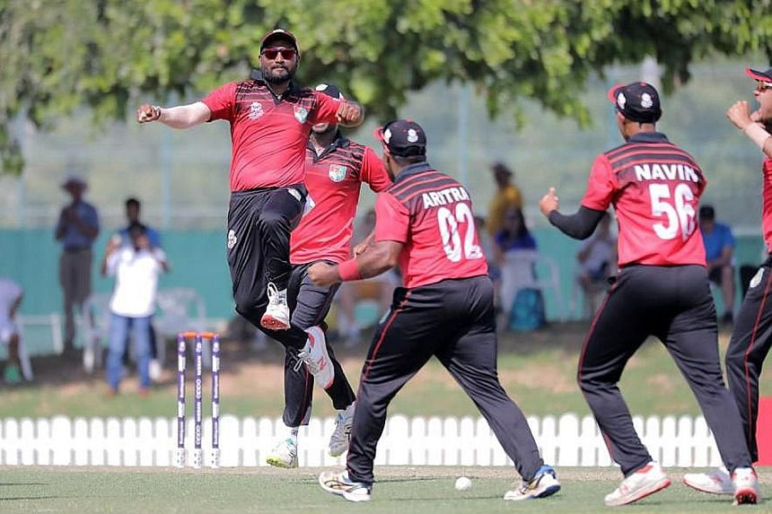 Singapore pipped Scotland in a last-ball thriller to win by two runs in Dubai on the first day of the T20 World Cup Qualifier.