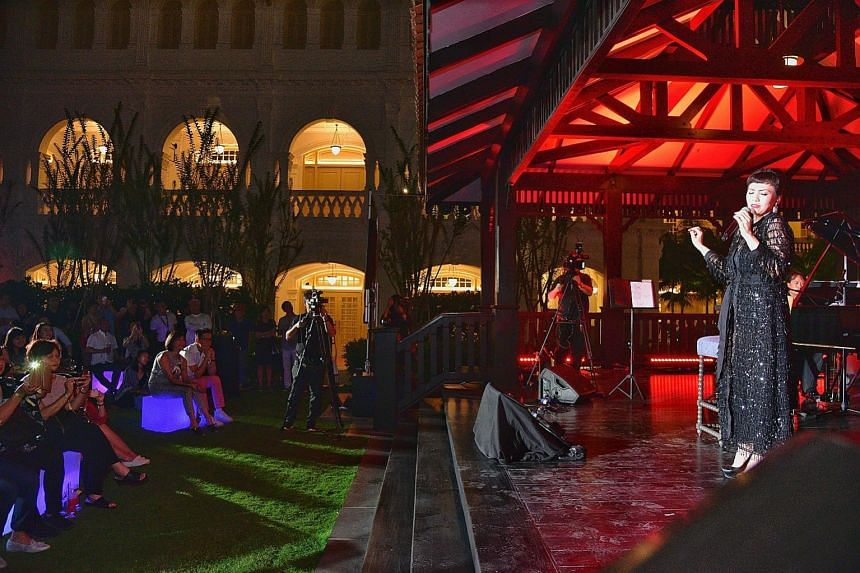 Above: Dancers performing outside Raffles Hotel as part its official unveiling last night. Right: Kit Chan singing at The Lawn of Raffles Hotel. Others who provided live entertainment included indie-pop band The Sam Willows, singer and songwriter Inc