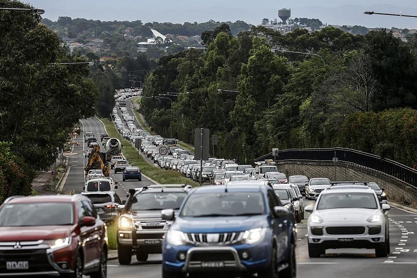 """In recent years, Australia has spent hundreds of billions of dollars on new roads, highways, tunnels and public transport, but these have done little to address long commute times. A report by the Grattan Institute says a """"modest"""" congestion charge i"""