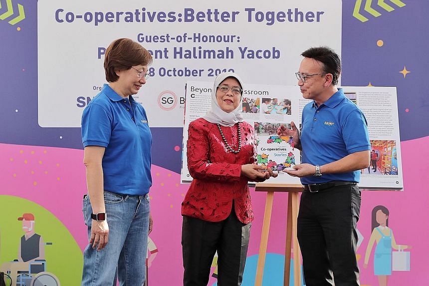 President Halimah Yacob with Singapore National Co-operative Federation (SNCF) chief executive Dolly Goh and SNCF chairman and NTUC LearningHub chief executive Kwek Kok Kwong at the launch of the book, Singapore Co-operatives, Singapore Stories, at t