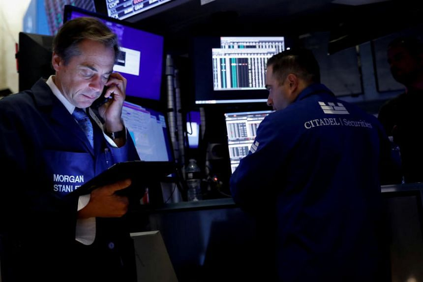 Traders work on the floor at the New York Stock Exchange (NYSE) in New York on Oct 18, 2019.