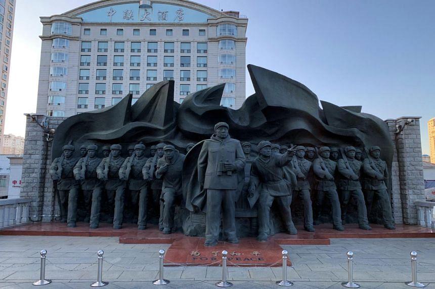 The communist memorial at the head of the Yalu River Broken Bridge in Dandong, China.