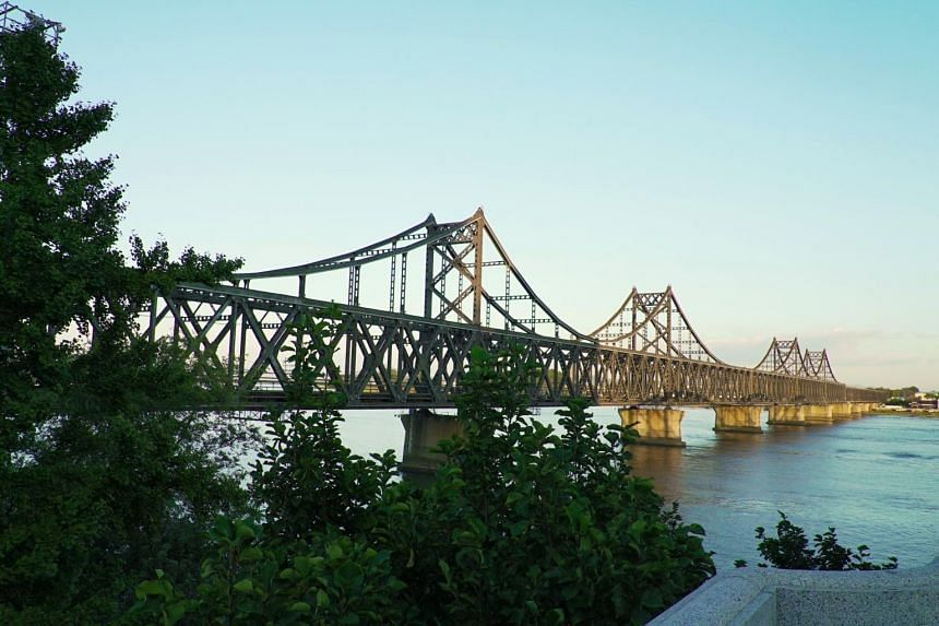 The Yalu River Broken Bridge in Dandong. It was bombed out during the US-Korean War and it is now converted into a tourist destination.