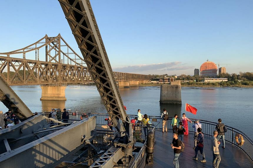 Visitors at The Yalu River Broken Bridge in Dandong.
