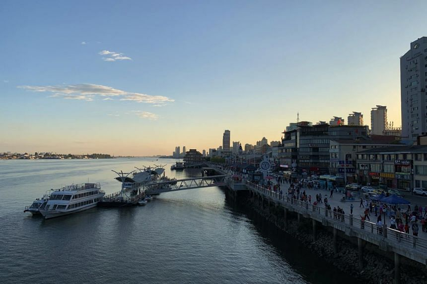 Sunset over the bustling Chinese city of Dandong.