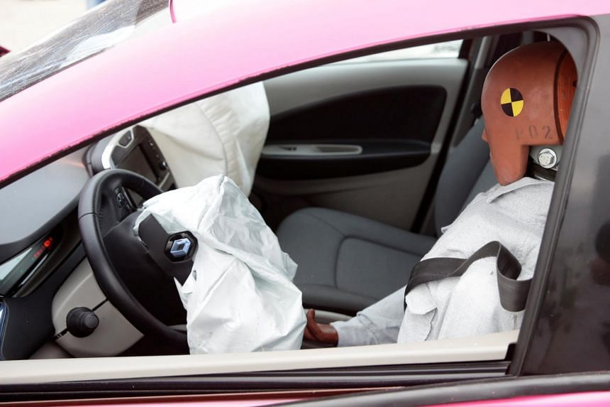 A crash test dummy is seen in the driver's seat of a car in Duebendorf, Switzerland, on Aug 22, 2019.