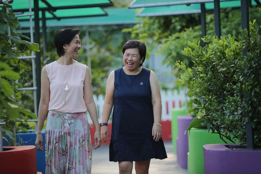 Ms Naruemon Saekhow (right) says Ms Tricia Pang helps her deal with different aspects of her experience with cancer.