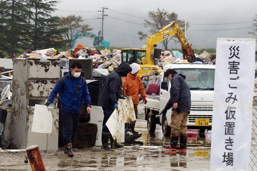Residents and volunteers at the trash collection point in Marumori town in Japan's Miyagi prefecture on Oct 19, one week after Typhoon Hagibis struck.
