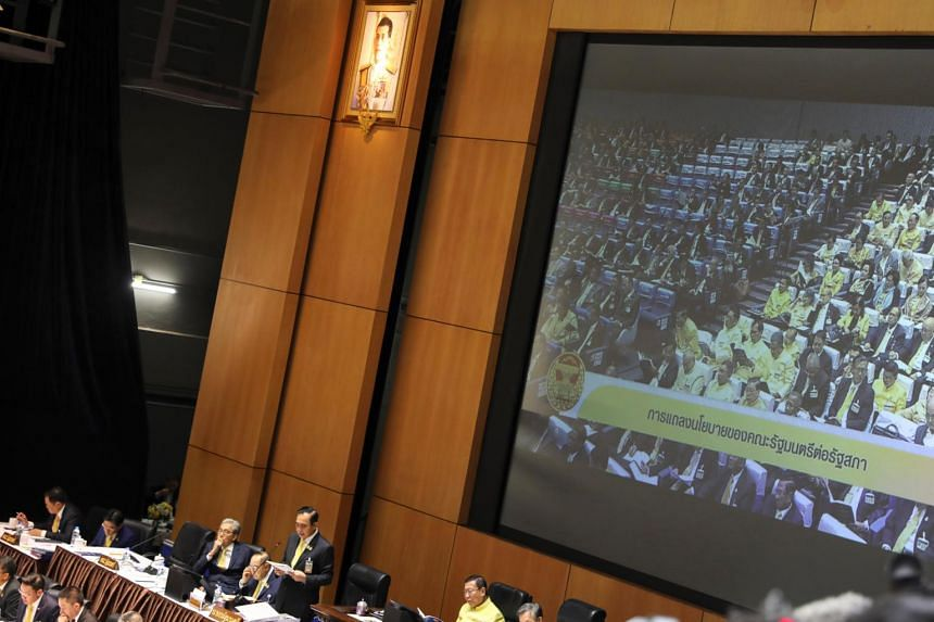 A photo taken on July 25 shows Thailand's Prime Minister Prayut Chan-ocha delivering the policy statement of the council of ministers in Parliament in Bangkok.