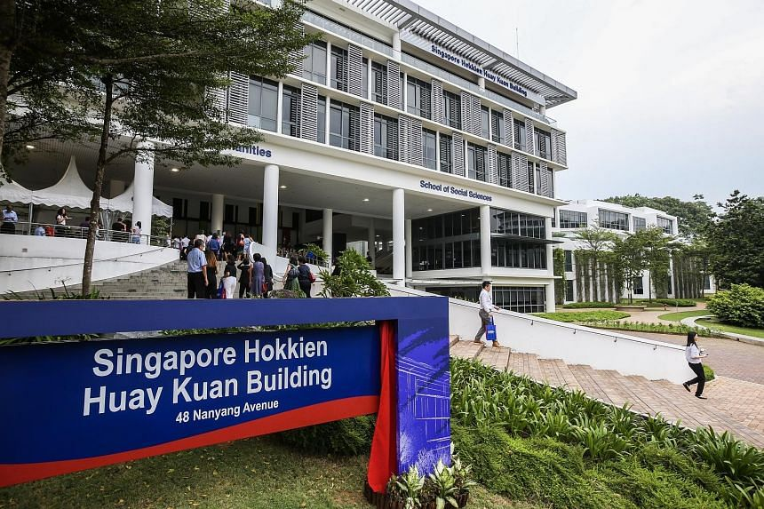 Alumni members taking photos yesterday at the newly renamed Tan Lark Sye Walk. Mr Tan Lark Sye had played a key role in setting up Nanyang University. The building that houses Nanyang Technological University's College of Humanities, Arts and Social