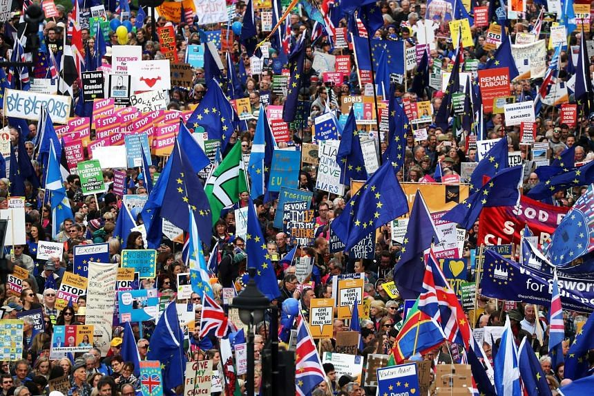 Supporters of the European Union marching in London as the British Parliament sat to discuss the fate of Brexit yesterday.