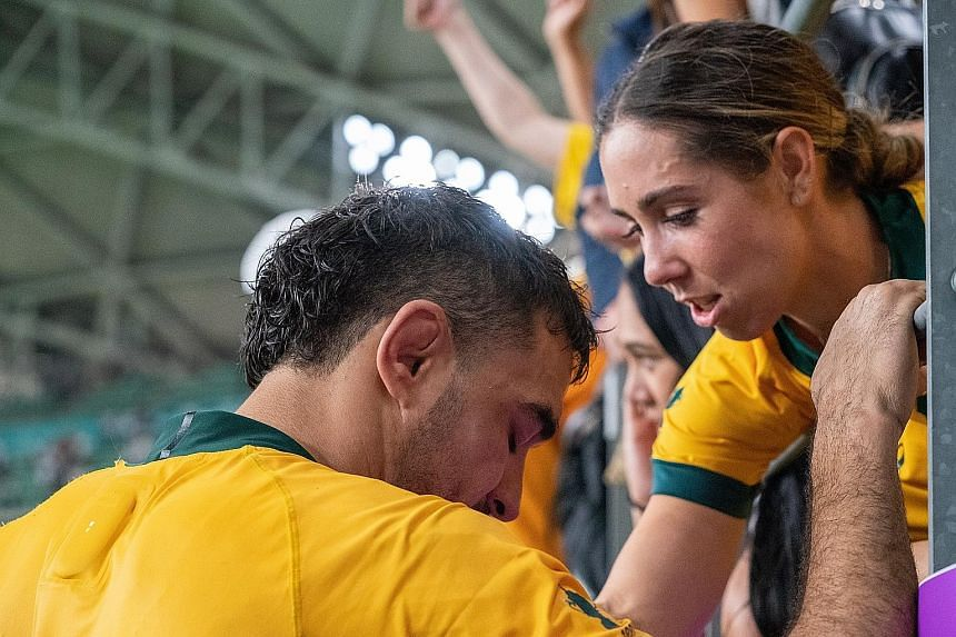 Australia's Rory Arnold is consoled after their 40-16 quarter-final loss.