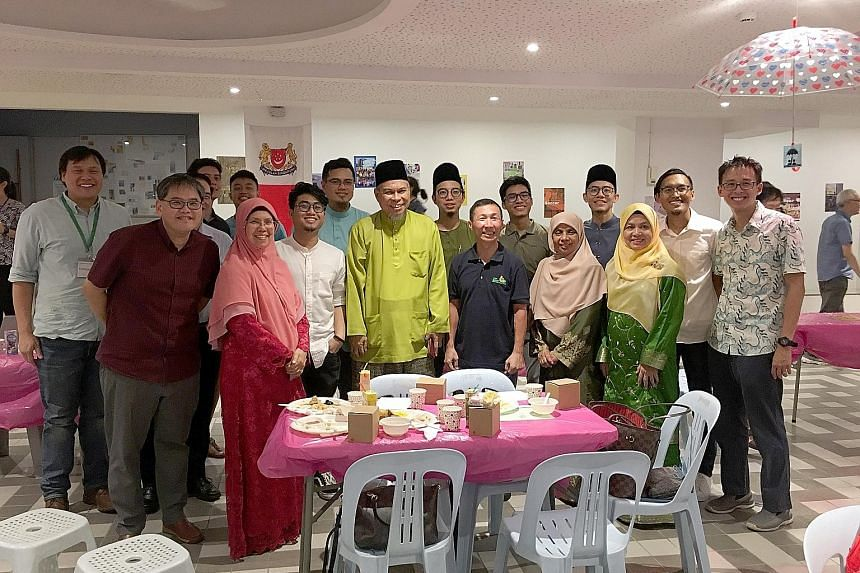 An-Nahdhah Mosque members and Ustaz Mohamed Ali Atan (centre, in green) attending Zion Bishan Bible-Presbyterian Church's 25th anniversary celebrations. Also present were church staff member Ng Zhi-wen (right) with Mr Saiful Anuar, founder of Muslim