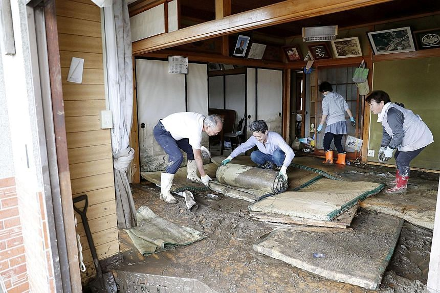 Marumori residents cleaning up a house that was affected by flooding caused by Typhoon Hagibis last Monday. PHOTO: REUTERS Residents and volunteers at the trash collection point in Marumori town in Miyagi prefecture yesterday, a week after Typhoon Ha