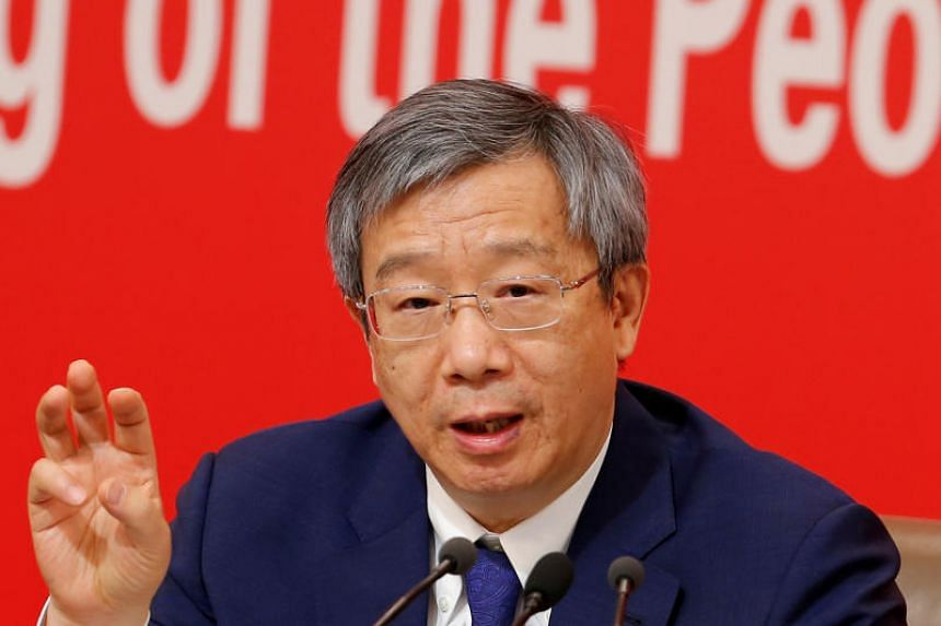 In a photo taken on Sept 24, 2019, Governor of People's Bank of China (PBOC) Yi Gang attends a news conference on China's economic development ahead of the 70th anniversary of its founding in Beijing.