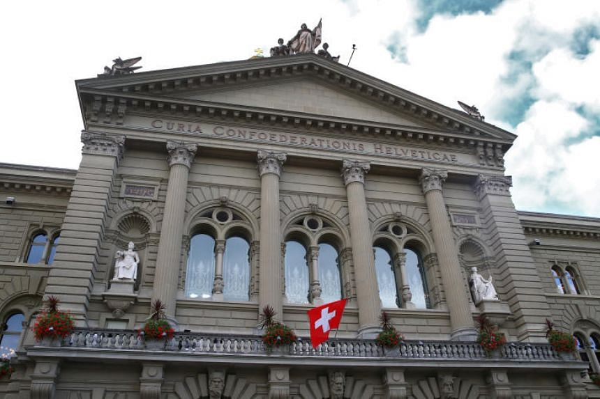 A Swiss flag is pictured, days ahead of federal elections, on the Swiss Parliament Building (Bundeshaus) in Bern, Switzerland on Sept 25, 2019.