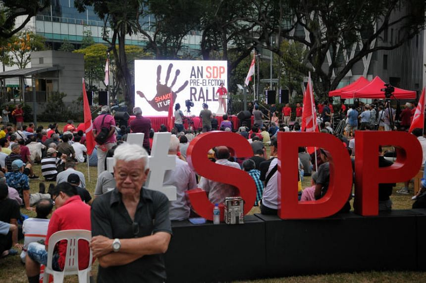 The crowd sings the national anthem during the Singapore Democratic Party (SDP) pre-election rally held at Hong Lim Park on Oct 19, 2019.