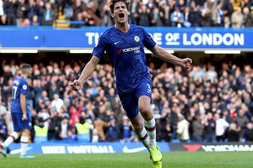 Chelsea's Marcos Alonso celebrates scoring his side's first goal during the English Premier League soccer match between Chelsea and Newcastle United at Stamford Bridge on Oct 19, 2019.