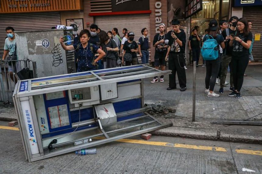 A telephone booth knocked over by protesters in Hong Kong's Mong Kok district on Oct 20, 2019.