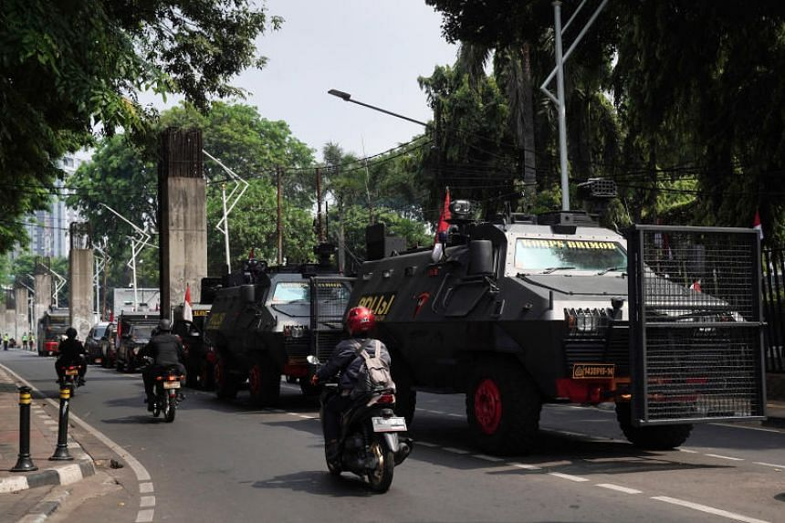 Police armoured vehicles parked near the National Parliament complex in Jakarta on Oct 20, ahead of the presidential inauguration.