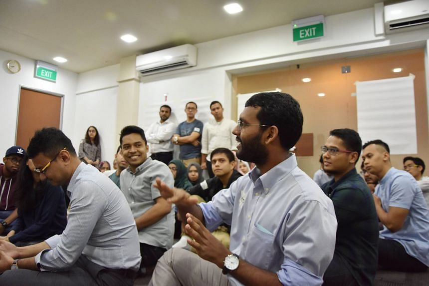 Participants at a workshop on diversity within the Singapore Muslim community. MCollective founder Saiful Anuar says the Muslim intra-faith group organises an annual Sunni-Shi'ite dialogue. Head of the Ba'alwie Mosque Habib Hassan says intra-reli