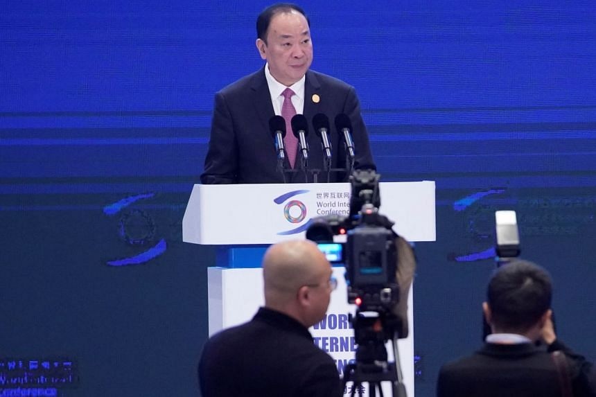 Mr Huang Kunming reading a message from Chinese President Xi Jinping at the opening ceremony of the World Internet Conference in Wuzhen, Zhejiang province, on Oct 20, 2019.