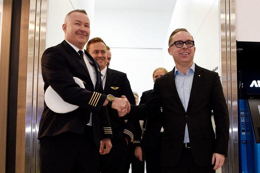 Qantas Captain Sean Golding and chief executive officer Alan Joyce arrive at Sydney International Airport in Australia on Oct 20, 2019, after flying non-stop from New York in 19 hours and 16 minutes.