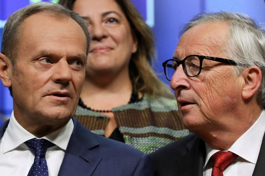 European Commission President Jean-Claude Juncker and President of the European Council Donald Tusk at the start of EU Tripartite Social Summit in Brussels, Belgium, on Oct 16, 2019.