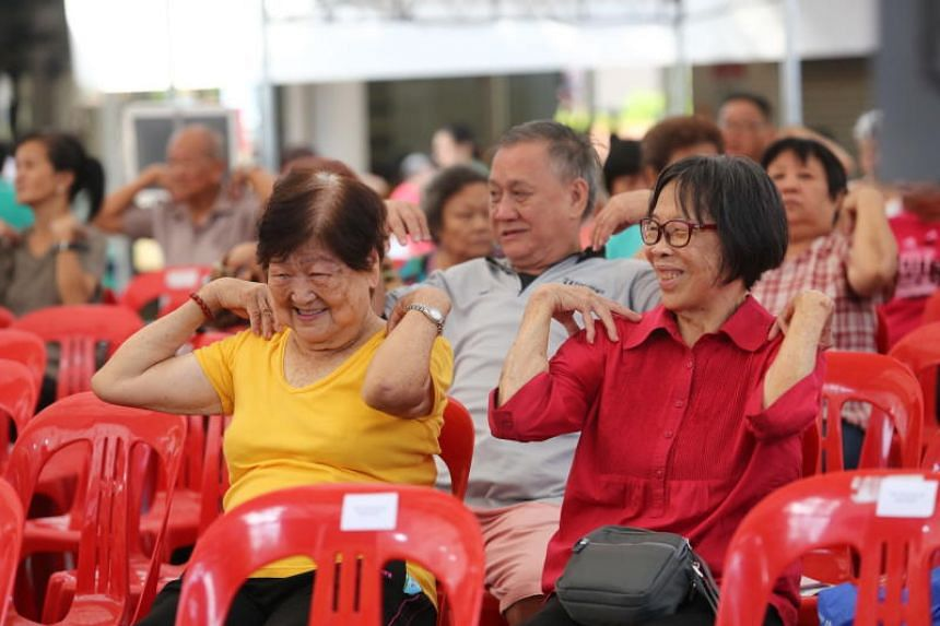 Participants take part in stretching exercises during Alexandra Hospital's community outreach event at Tanglin Halt on Oct 20, 2019.