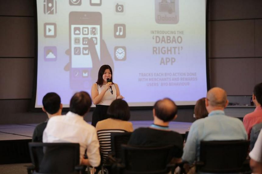 """Marketing manager Lee Peilin presenting her team's Dabao Right mobile app during a workgroup on """"recycling right"""", organised by the Ministry of Environment and Water Resources, on Oct 20, 2019."""