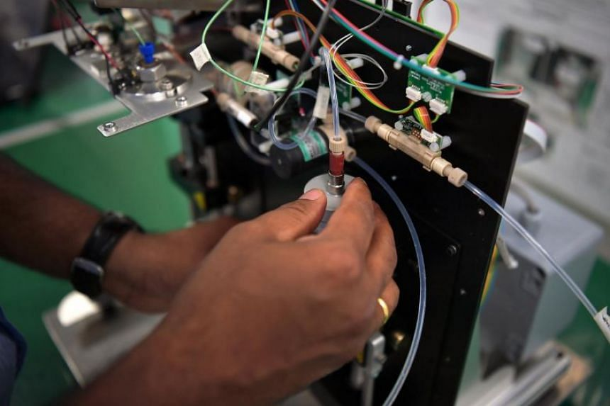 A photo taken on Feb 11 shows an engineer working on a medical system for a company that designs and manufactures high-value medical devices and lab equipment.