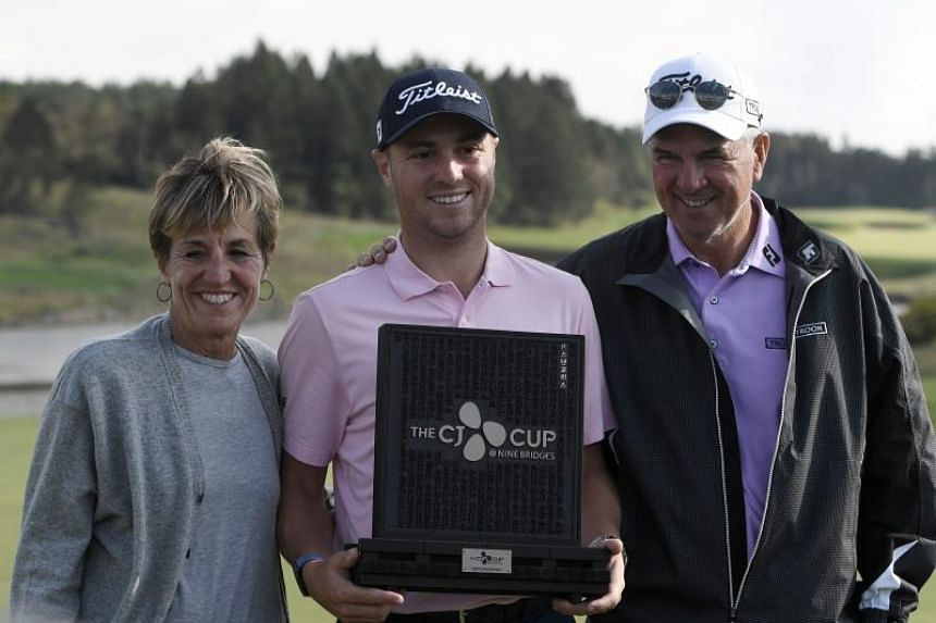 Justin Thomas with his parents after winning the CJ Cup golf tournament at Nine Bridges golf club in Jeju Island, South Korea, on Oct 20, 2019.