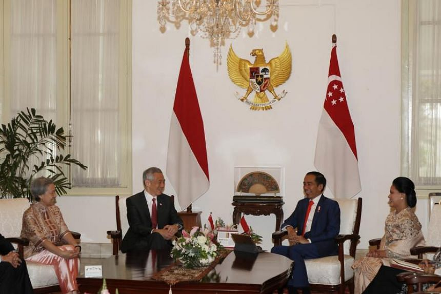 Prime Minister Lee Hsien Loong calls on Indonesian President Joko Widodo at the Istana Merdeka in Jakarta on Oct 20, ahead of Mr Joko's inauguration for a second term.