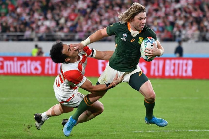 South Africa's Faf de Klerk scores a try during the Rugby World Cup quarter-final match against Japan at Tokyo Stadium on Oct 20, 2019.