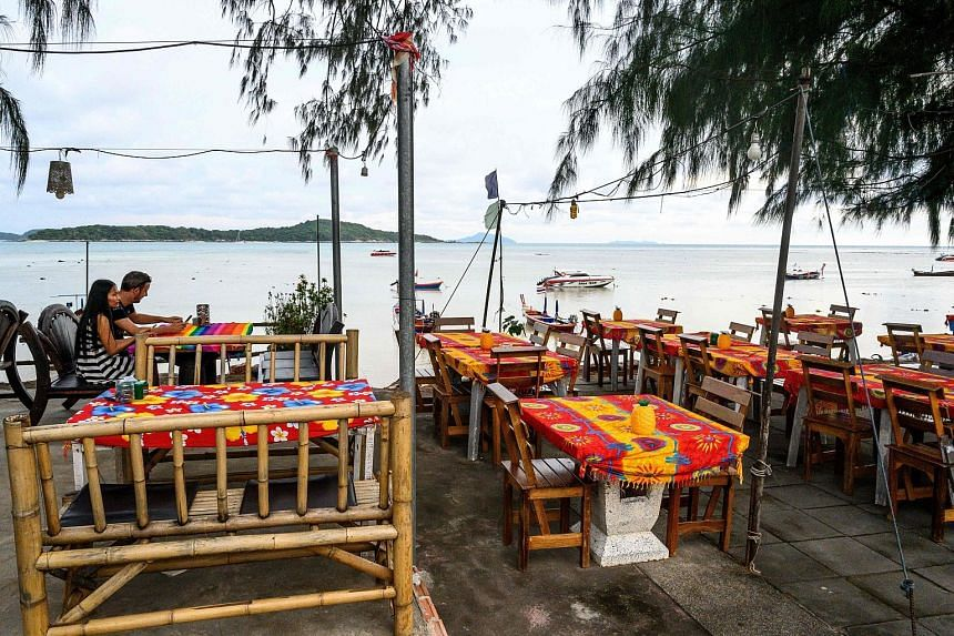A mostly empty restaurant in Phuket this month. Hotels on Thailand's most popular holiday island have been forced to slash prices, with rooms left vacant and beaches sparse, as tourist chiefs struggle with a plunge in visitors from China.