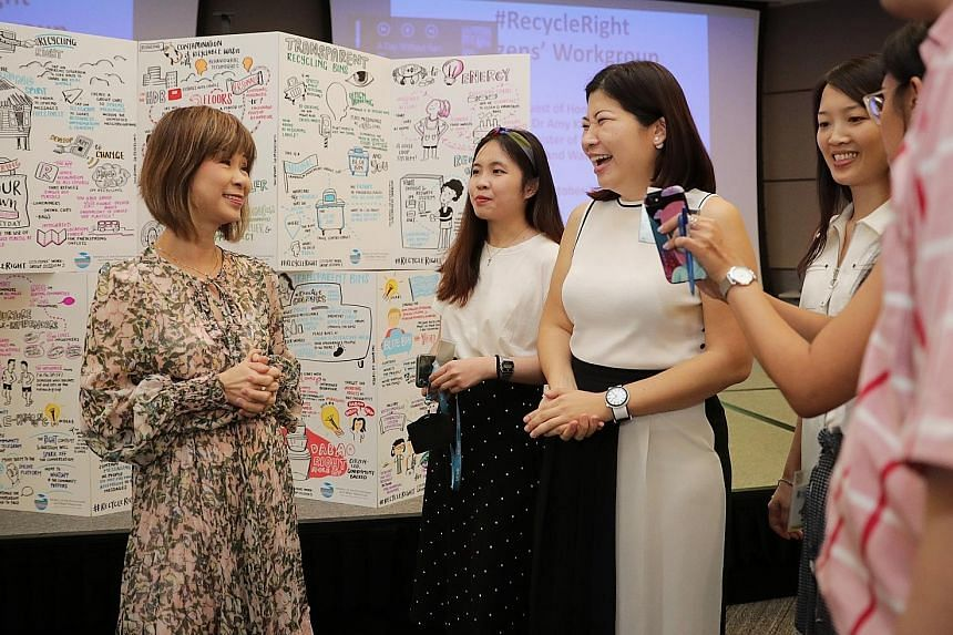 (From left) Senior Minister of State for the Environment and Water Resources Amy Khor with Ms Rachel Chua, Ms Lee Peilin and Ms Lam Yimin at the Ministry of the Environment and Water Resources yesterday. The trio are part of the team that proposed pr