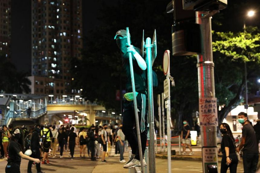 Protesters during a rally marking the third-month anniversary of alleged triads members attacking protesters and residents in Hong Kong's Yuen Long district on Oct 21, 2019.