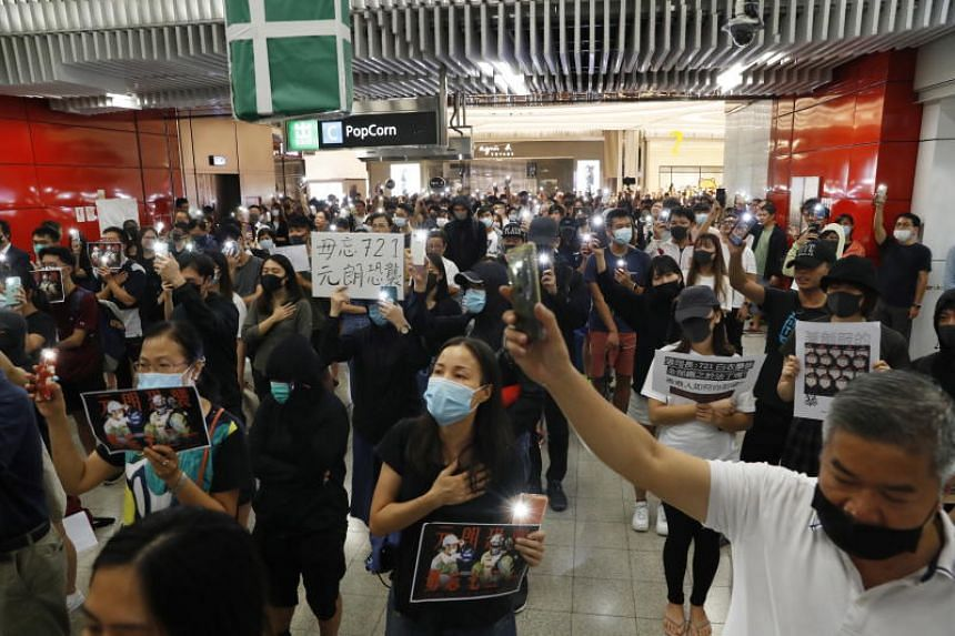Protesters during a rally in Tseung Kwan O MTR station in Hong Kong on Oct 21, marking the third-month anniversary of alleged triads members attacking protesters and residents in Yuen Long.