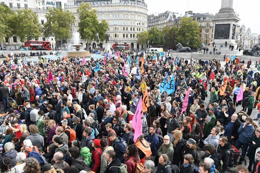 Demonstrators assemble in Trafalgar Square during a protest for climate change in London, Britain, on Oct 16, 2019. Citizens around the world, including young people, have recognised climate change as a defining issue of their time.