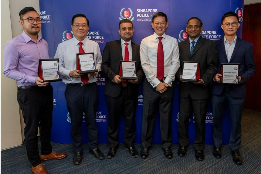 Mr David Chew (third from right), director of Commercial Affairs Department, with representatives from DBS Bank, OCBC Bank, UOB, Resorts World Sentosa and Marina Bay Sands. They were commended on Monday (Oct 21) for aiding the police in seizing $25 m