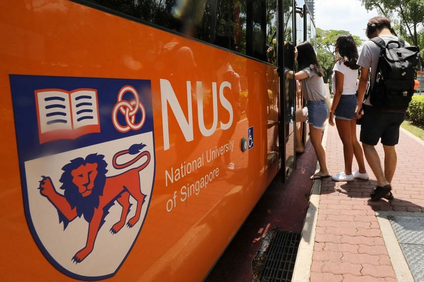 Students boarding a National University of Singapore (NUS) shuttle bus.