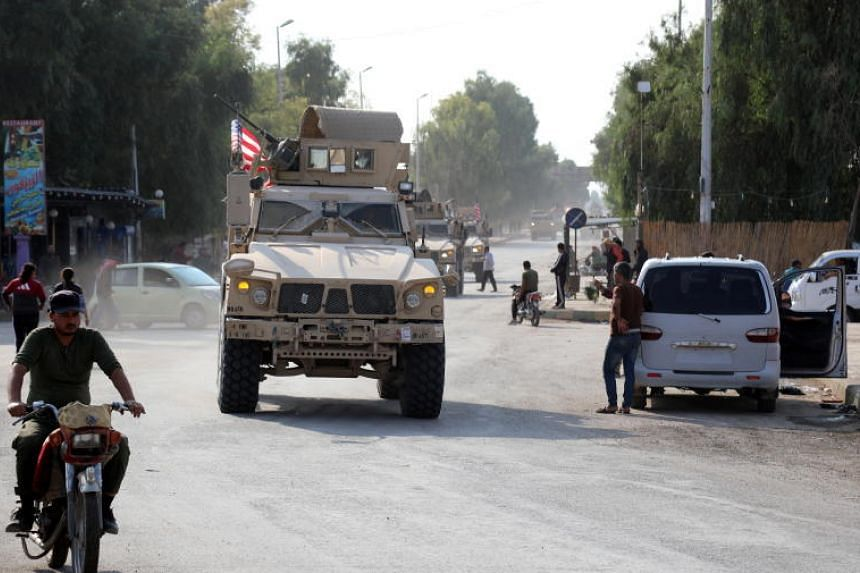 A convoy of US troops head towards the Iraqi border in north-eastern Syria on Oct 20, 2019.