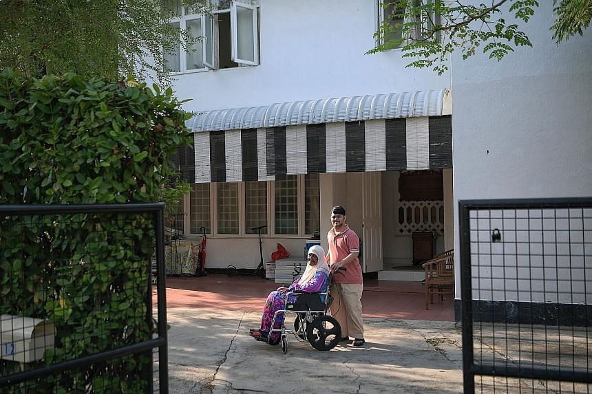 Mr Barkath Ali Abu Bakar and his grandmother Hasana Ahmad at her house in Jalan Binjai earlier this month. Madam Hasana, who is the longest-staying resident in the Katong estate, will have to say goodbye to her home when her lease is up in December n