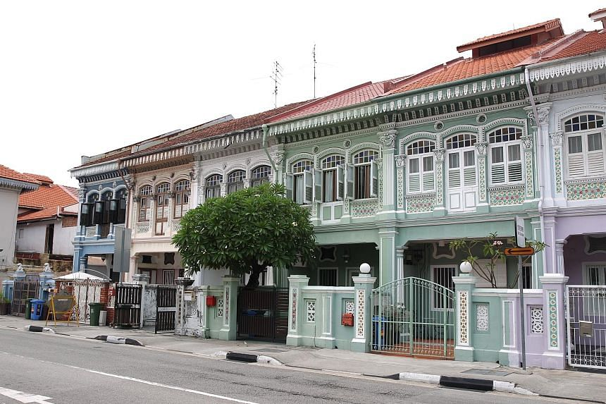 Left: Temasek Shophouse in Orchard Road was the sole winner of the Urban Redevelopment Authority's award for restoration at the annual Architectural Heritage Awards. Above: A row of 1920s and 1930s shophouses in Koon Seng Road that URA conserved in 1