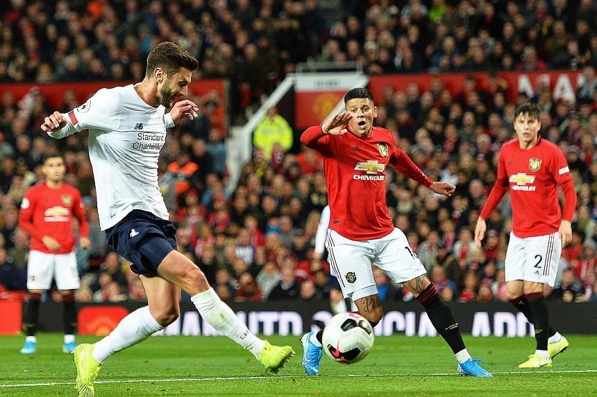 Liverpool midfielder Adam Lallana scoring the equaliser in the 1-1 Premier League draw at Manchester United on Sunday, as Marcos Rojo (centre) and Victor Lindelof watch on. PHOTO: EPA-EFE