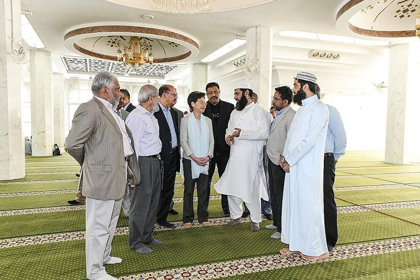 Hong Kong Chief Executive Carrie Lam visiting the mosque in Tsim Sha Tsui yesterday to meet members of the Islamic Trust, a community group. She apologised for the inadvertent spraying of the mosque's main entrance and gate with coloured water during