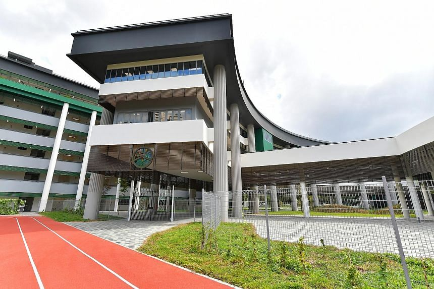 The new campus (above) at Braddell Rise is about 2.5ha larger than the old one in Anderson Road, and has a performing arts centre and innovation hub.