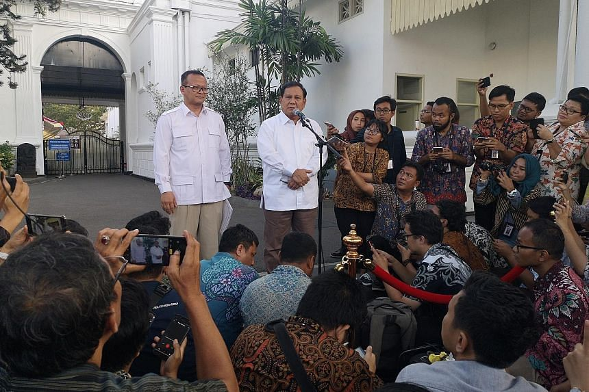 Gojek co-founder Nadiem Makarim yesterday confirmed he has been offered a position in the new Indonesian Cabinet. PHOTO: REUTERS Indonesia's opposition leader Prabowo Subianto speaking to reporters after meeting President Joko Widodo yesterday. With